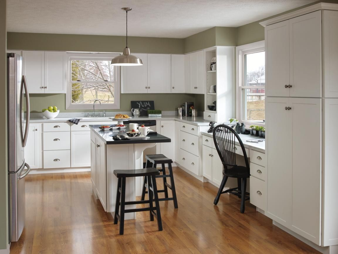 The Transitional Style Of Aristokraft S Vanwyke Cabinets With A Crisp White Finish White Shaker Kitchen Cabinets White Shaker Kitchen Shaker Kitchen Cabinets
