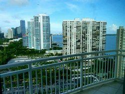 2475 BRICKELL AV 2105, Miami, Fl. 33129 - BREATHTAKING VIEWS OF BAY AND DOWNTOWN SKYLINE. MARBLE AND WOOD FLOORS. WASHER AND DRYER INSIDE UNIT.GRANITE TOPS, TENNIS, POOL, SAUNA, GYM, VALET PARKING. IMPACT SCREENS.
