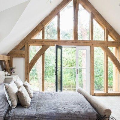 glazed gable in the bedroom, Carpenter Oak Frame House Timber frame bedroom.
