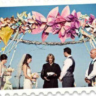 Oversized paper flower wedding arch