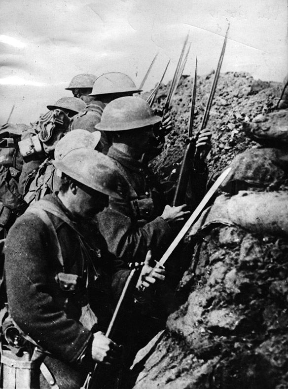 Canadian troops fix bayonets before going over the top on ...