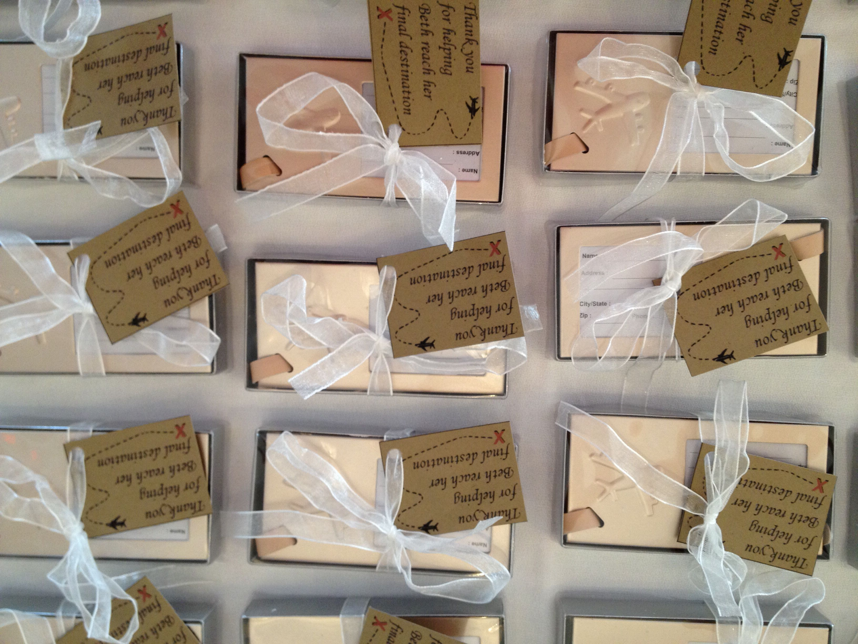 Travel suitcase tags for the favors for the brides shower! The guests loved them.