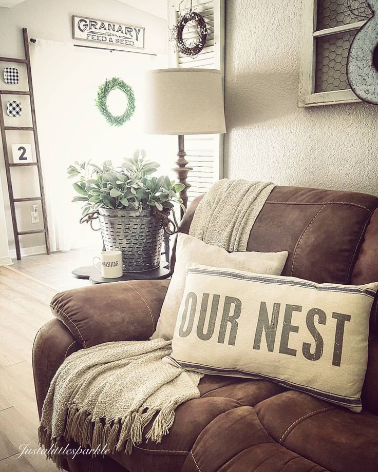 Living Room decor - rustic farmhouse style. Featuring rustic pillow, wood ladder decor, chicken wire wall hanging, white painted shutter in a neutral white color palette.