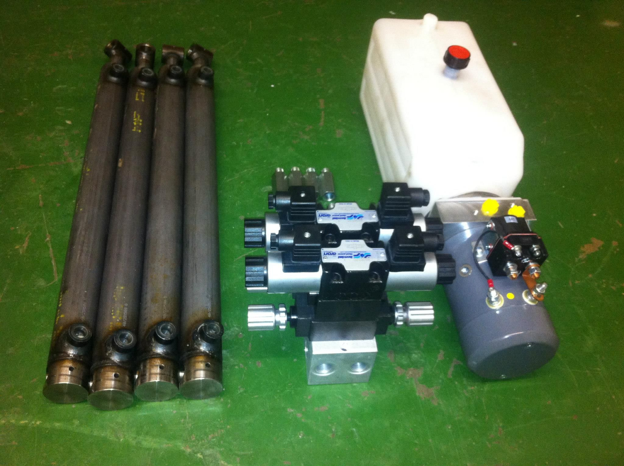 Complete hydraulic system designed for a new customer comprising: G Series 24vDC mini hydraulic power pack, hose burst valves and double acting cylinders. For more information click here http://www.hydraulicsonline.com/hydraulic-system-design