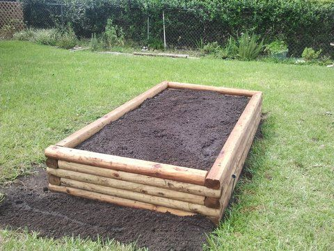 Raised garden bed plans using landscape timbers garden for Diy patio bed