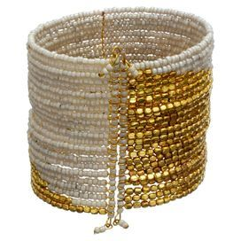 Stretch cuff bracelet with white and golden beads.  Product: CuffConstruction Material: Metal and acrylicColor: White and goldFeatures: Stretches for an easy fit