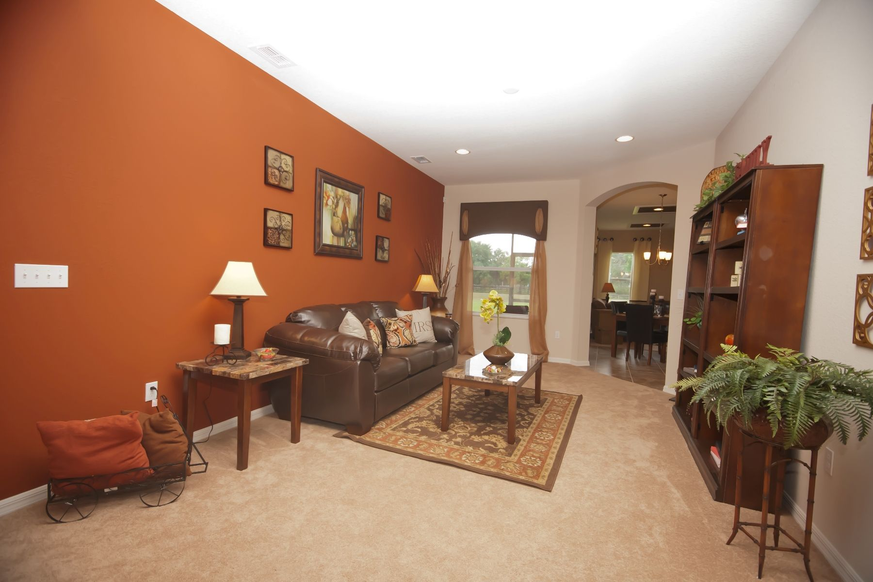Burnt orange accent wall perfectly pairs with the neutral