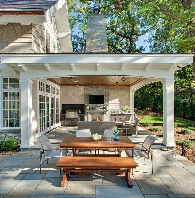 beach style patio featuring stone slab floors a wooden outdoor dining area a stone - Stone Slab Dining Room Decorating