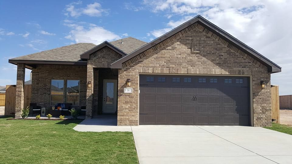 4: French Chateau Brick with chocolate stucco, garage door and