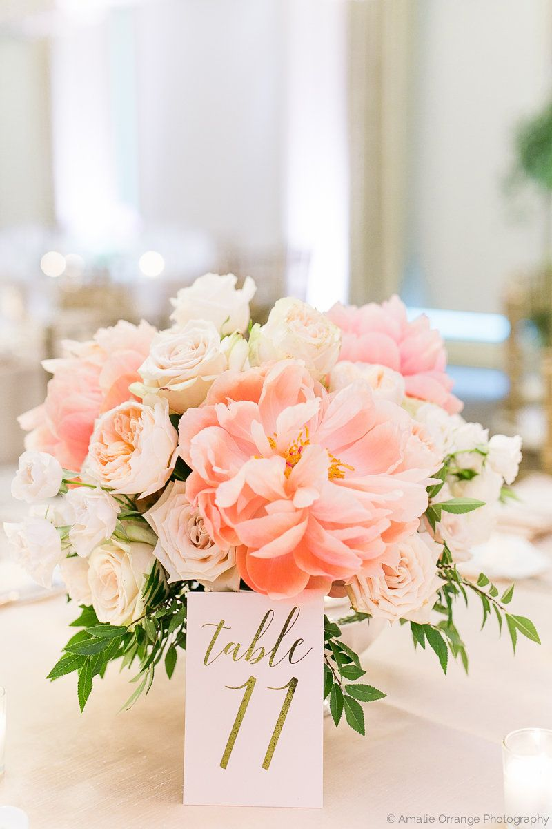 A lush spring time wedding table arrangement of faded for Bridal table arrangements