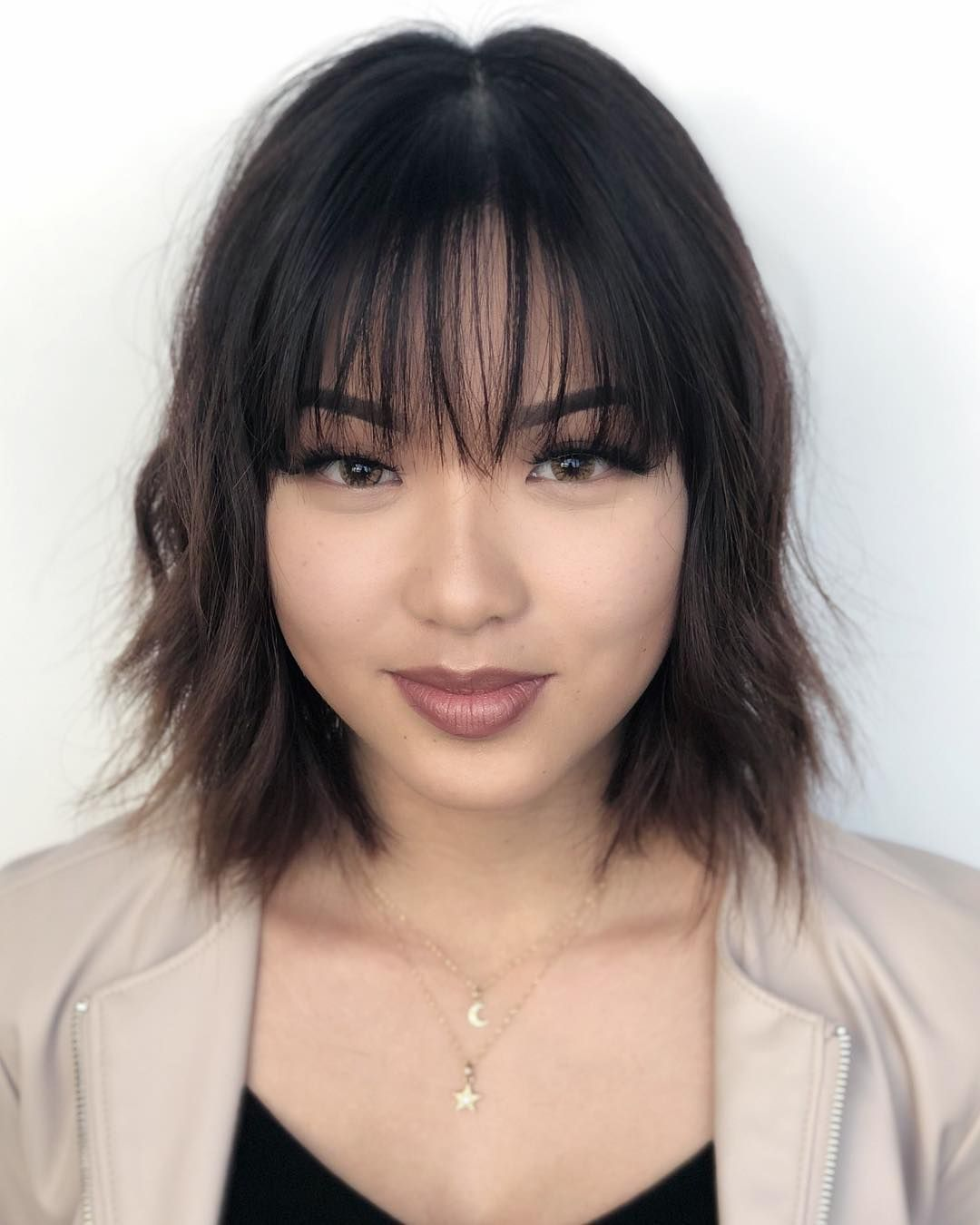 Women's Chic Wavy Textured Bob with Thin Wispy Bangs and Subtle Brunette Balayage Medium Sexy Trending Feminine Hairstyle