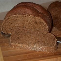Machine Pumpernickel Bread A hearty, healthy bread that combines bread, rye, and whole wheat flours with cocoa and molasses.A hearty, healthy bread that combines bread, rye, and whole wheat flours with cocoa and molasses.