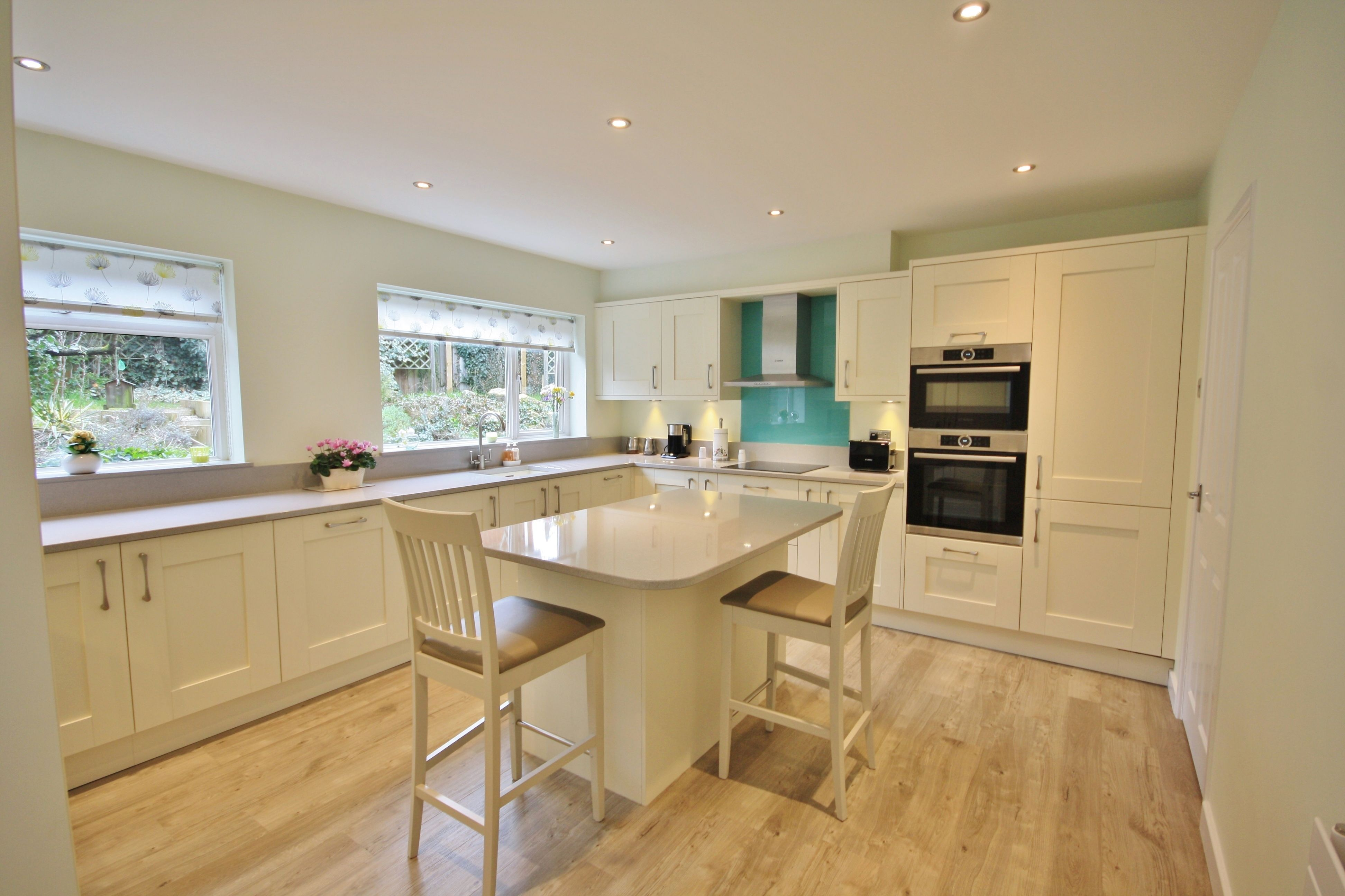 Shaker Kitchen Design In Ivory, With Light Grey Worktops.