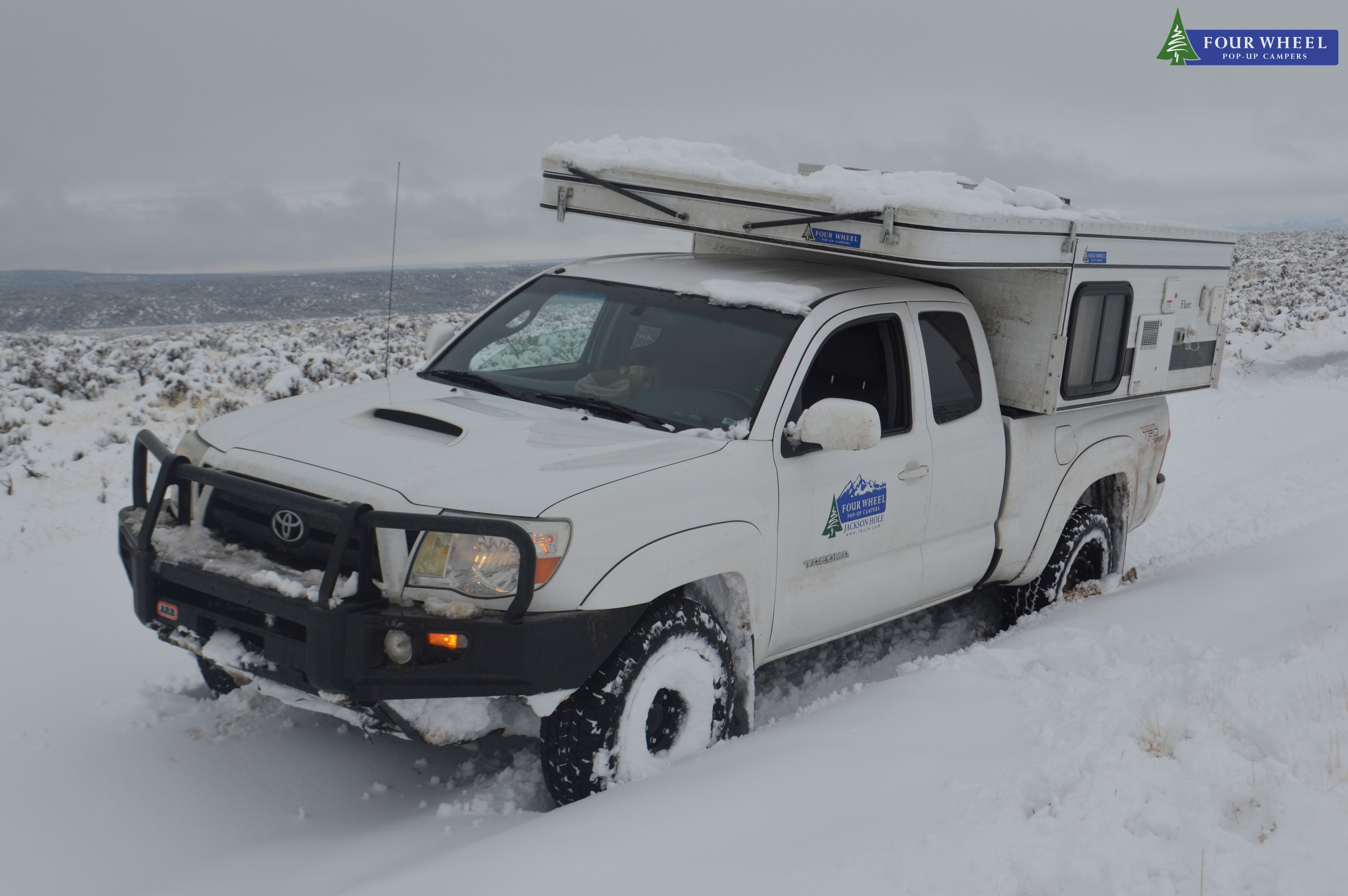 Vanlife in a pick-up truck camper in a deep snow. # ...