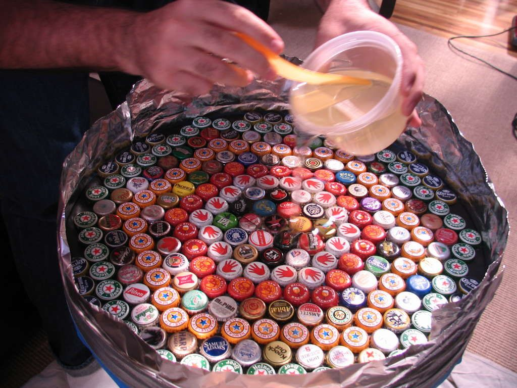 Bottle cap table how to, plus lots of other tips on resin & bottle cap projects, etc