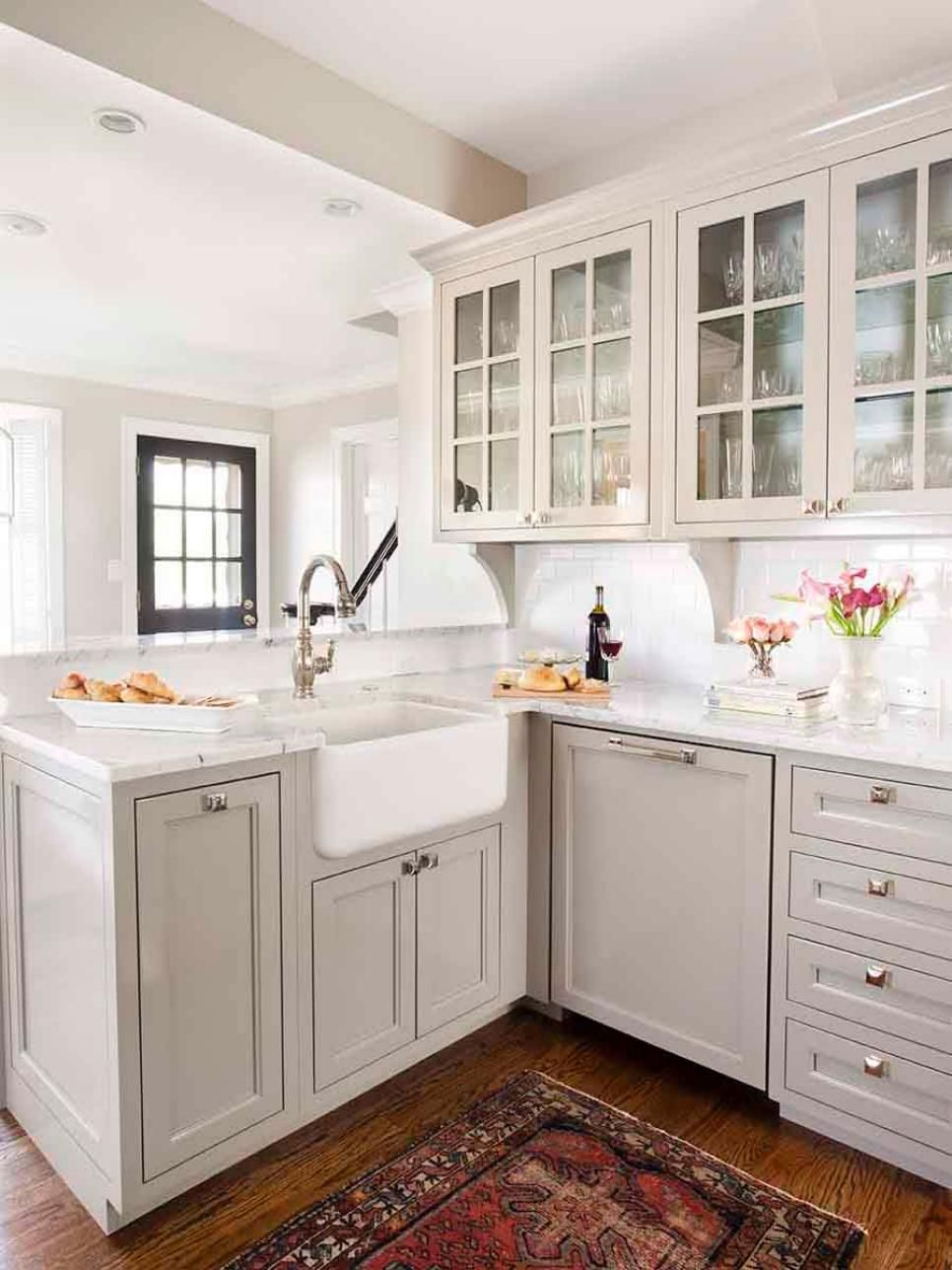 A lovely pale gray palette and marble countertops look soft and ...