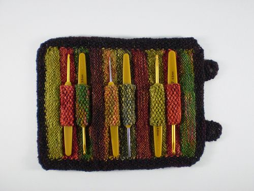 Shetland Stripes - four patterns in one. There's a crochet hook roll, a bank card case, a wallet for a notebook and pen and a knitting kit