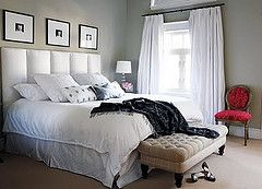 love the tufted bench and photos above the bed
