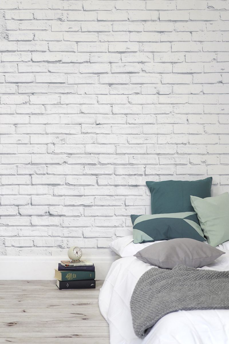 This whitewashed brick wallpaper design works so well in for Grey brick wallpaper bedroom