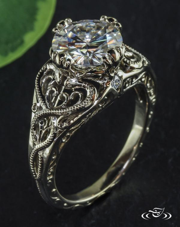 Antique Intertwining Snake Engagement RingCast in warm white gold, the shoulders of this unique engagement ring feature snakes intertwining amongst antique filagree. A hand engraved scroll pattern accents the side faces.#Ido #GreenLakeMade #EngagementRing