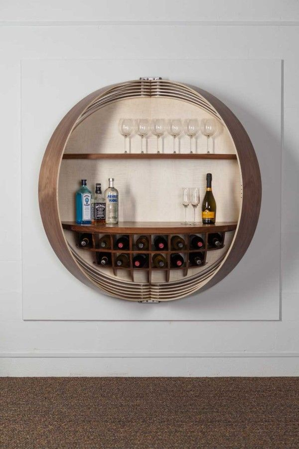 A Wall Mounted Bar Cabinet Inspired By A Spinning Coin Design