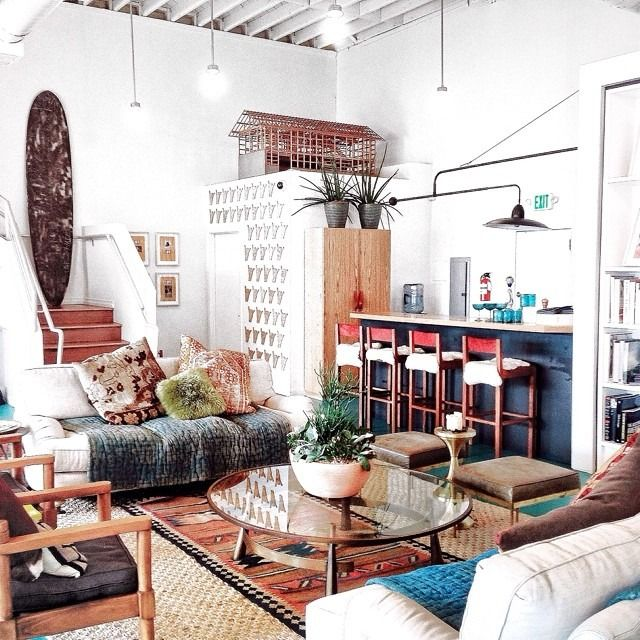 Maybe two matching chairs under the window? Coffee table! Living