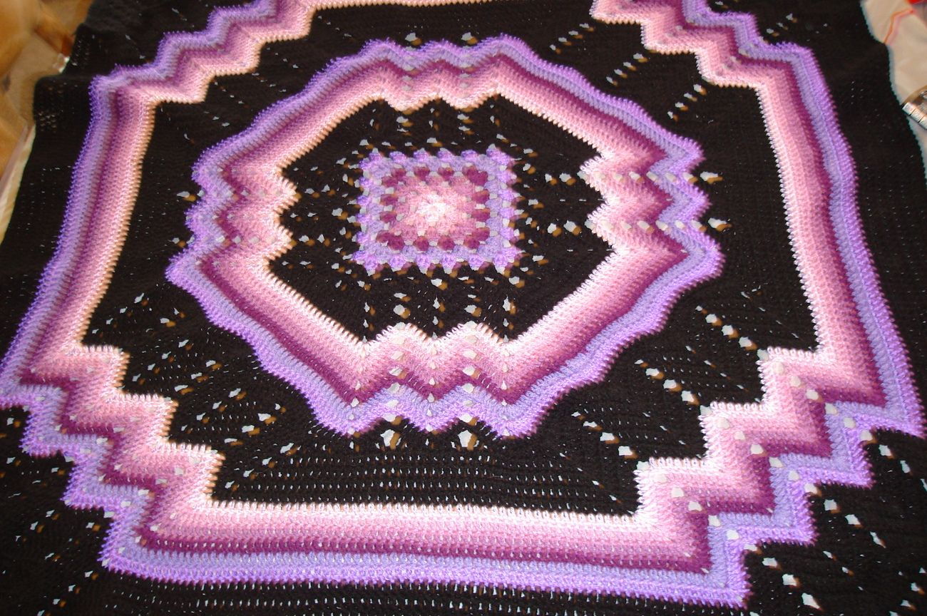 Crocheted afghan, multi-colored purples/black granny/ripple pattern ...