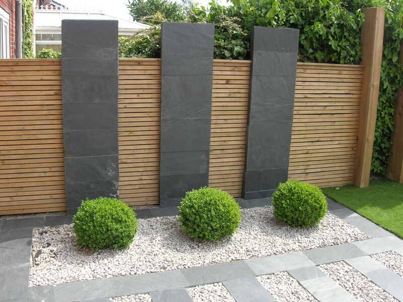 Black slate flagstones modern patio landscaping for Garden fence features