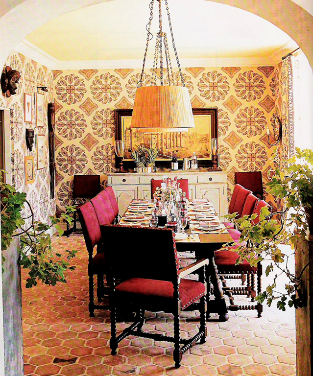 Tiled/wallpapered Walls In A Dining Room, Spanish Style, Chandeliers With  Shades,