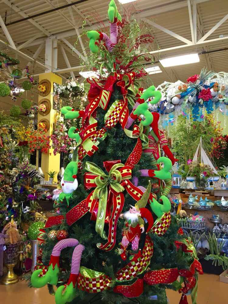 elf legs whimsical christmas tree designed by arcadia floral