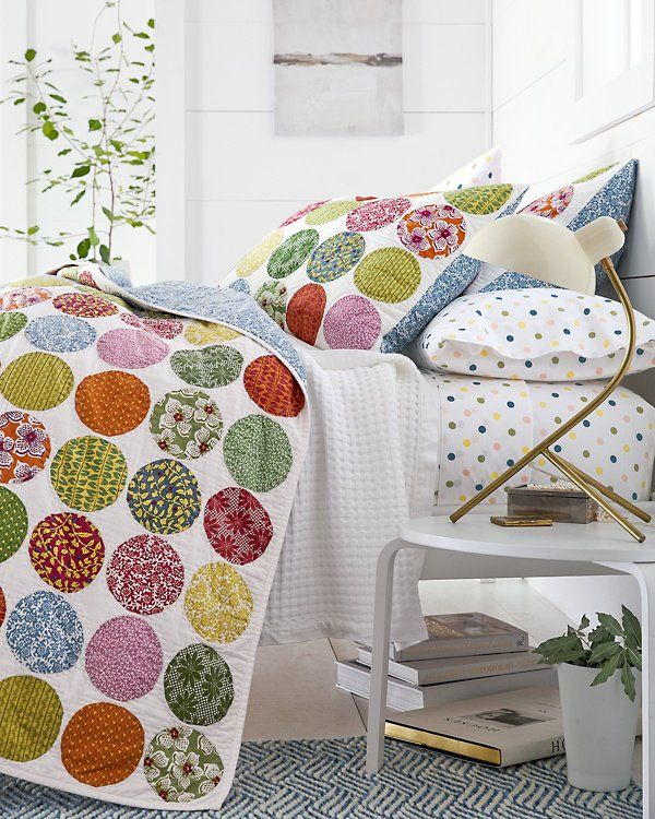 Our cheery Johanna Quilt features circular patches of