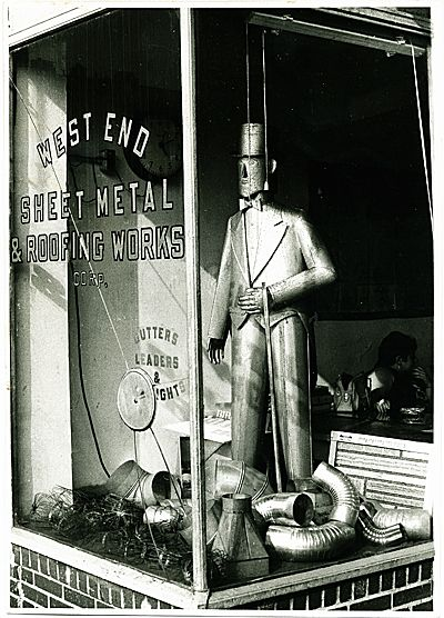 Photo By David Godsmith Sculpture In The Window Of Goldsmith S West End Sheet Metal And Roofing Works In Li Cit Vintage Storefront Sheet Metal Roofing Tin Man