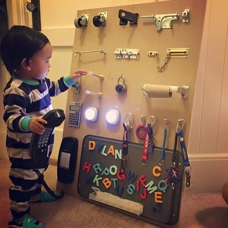 Take all the things you kid loves playing with around the house (like wheels, hinges, toilet roll holders, locks, pocket calculators, telephones, key chains, etc.) and fix them all onto an activity board to keep them busy.