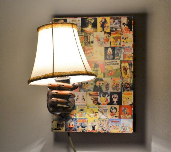 #comicbooklamp #kidslamp #childrensroomdecor #handlamp #mannequinlamp #recycledlamp #mancave #LimitedEditionIn #madeinIndia #etsy   Enlighten Golden Age of cartoon network!!  This lamp shade features different comic covers & characters that the 80's kids grew up with. Phantom, Mandrake, Duck tales, Jetsons, Scooby doo, Tintin, Asterix & Obelix and many more. They are both made from upcycled wooden books discarded by someone.