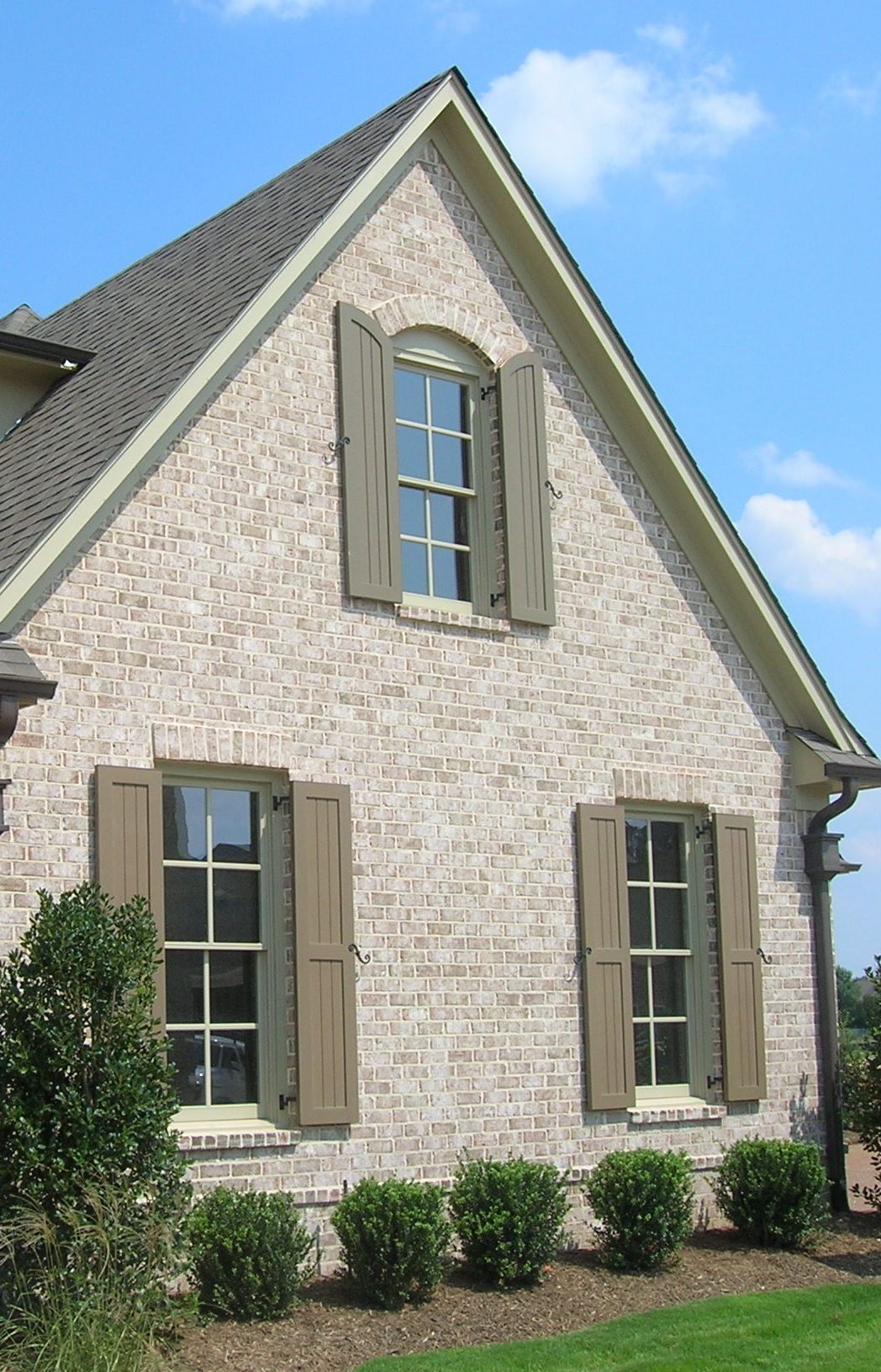 The Side Of A Brick Home Can Be Just As Dramatic As The Front Add A Segmental Arch And Brick Sill To The Brick Exterior House Shutters Exterior House Exterior