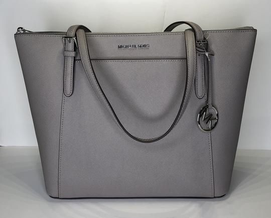 4ad659470ed3 Save big on the Michael Kors Ciara Large East West Tz Tote Pearl Grey  Leather Satchel! This satchel is a top ...
