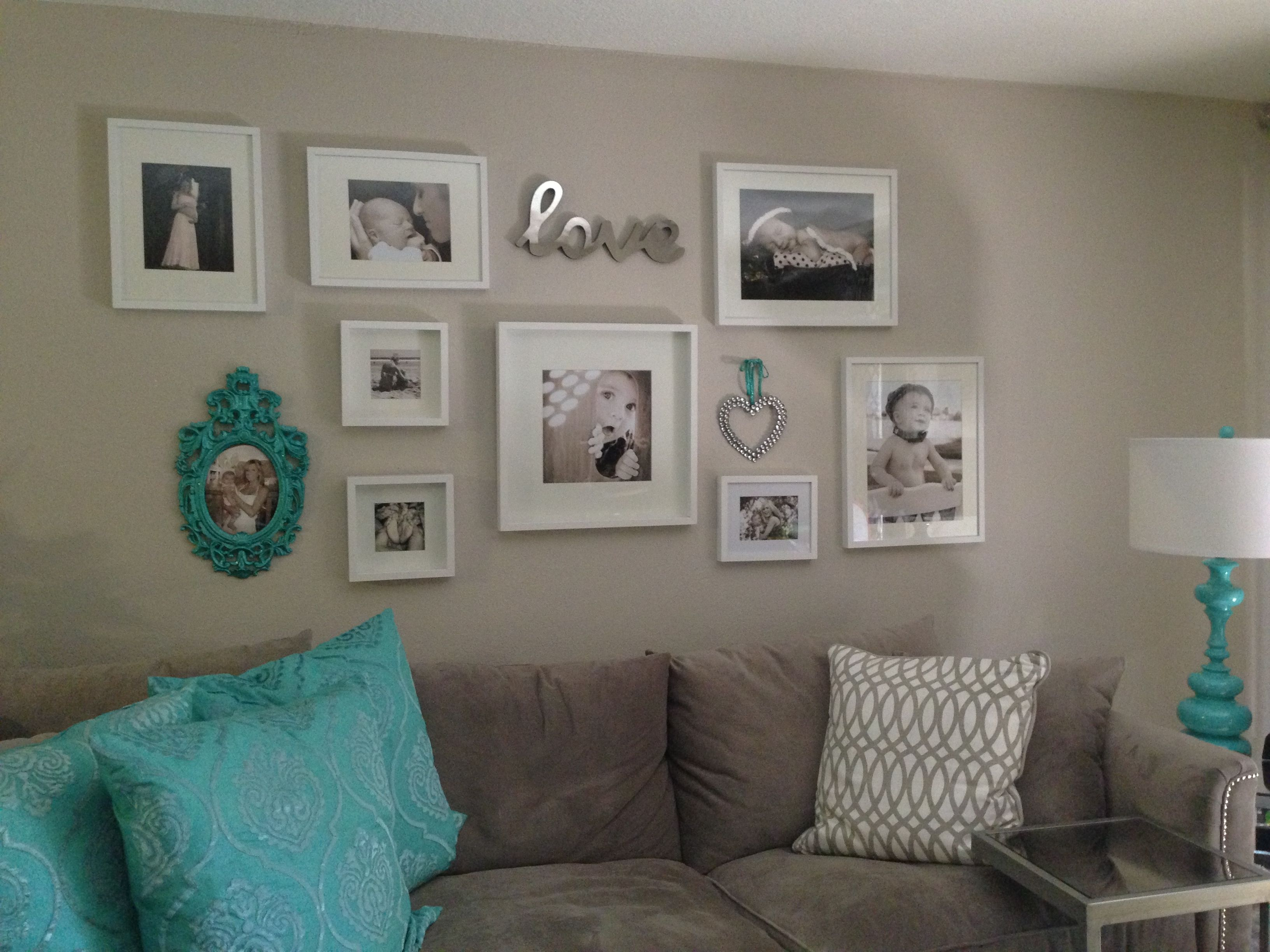 White And Aqua Photo Wall In My Living Room Using White Frames