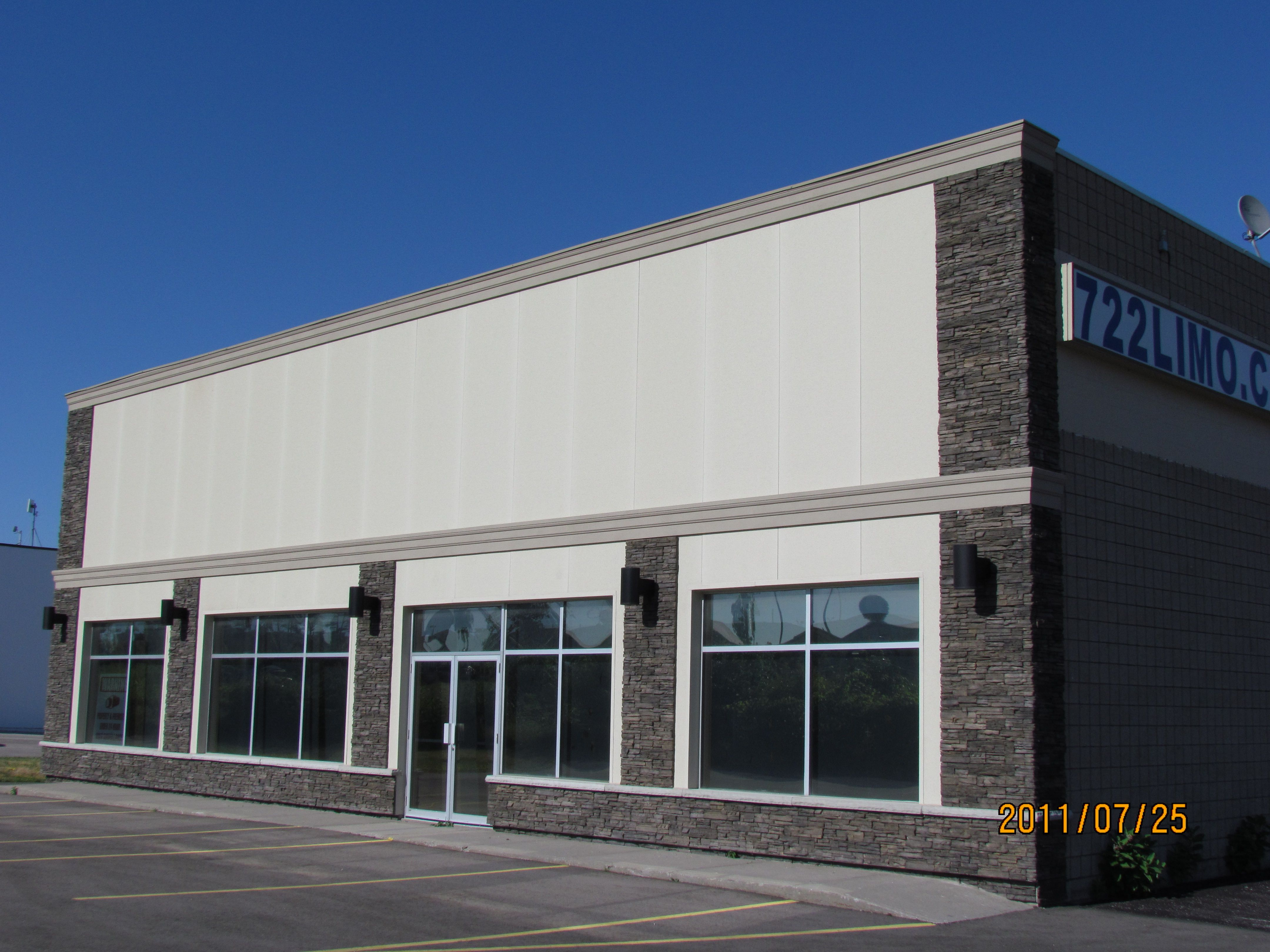 updated commercial building by using cultured stone on commercial office paint colors id=79919