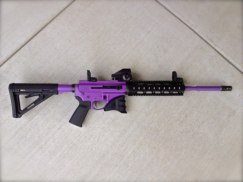 Bright purple this is sweet ladies notice the purple barrel and how the contrast is seen through the black rail