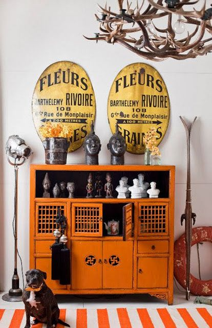 I've been loving all the orange lately. I don't know if it's a Halloween holdover or what but this cabinet is fantastic.