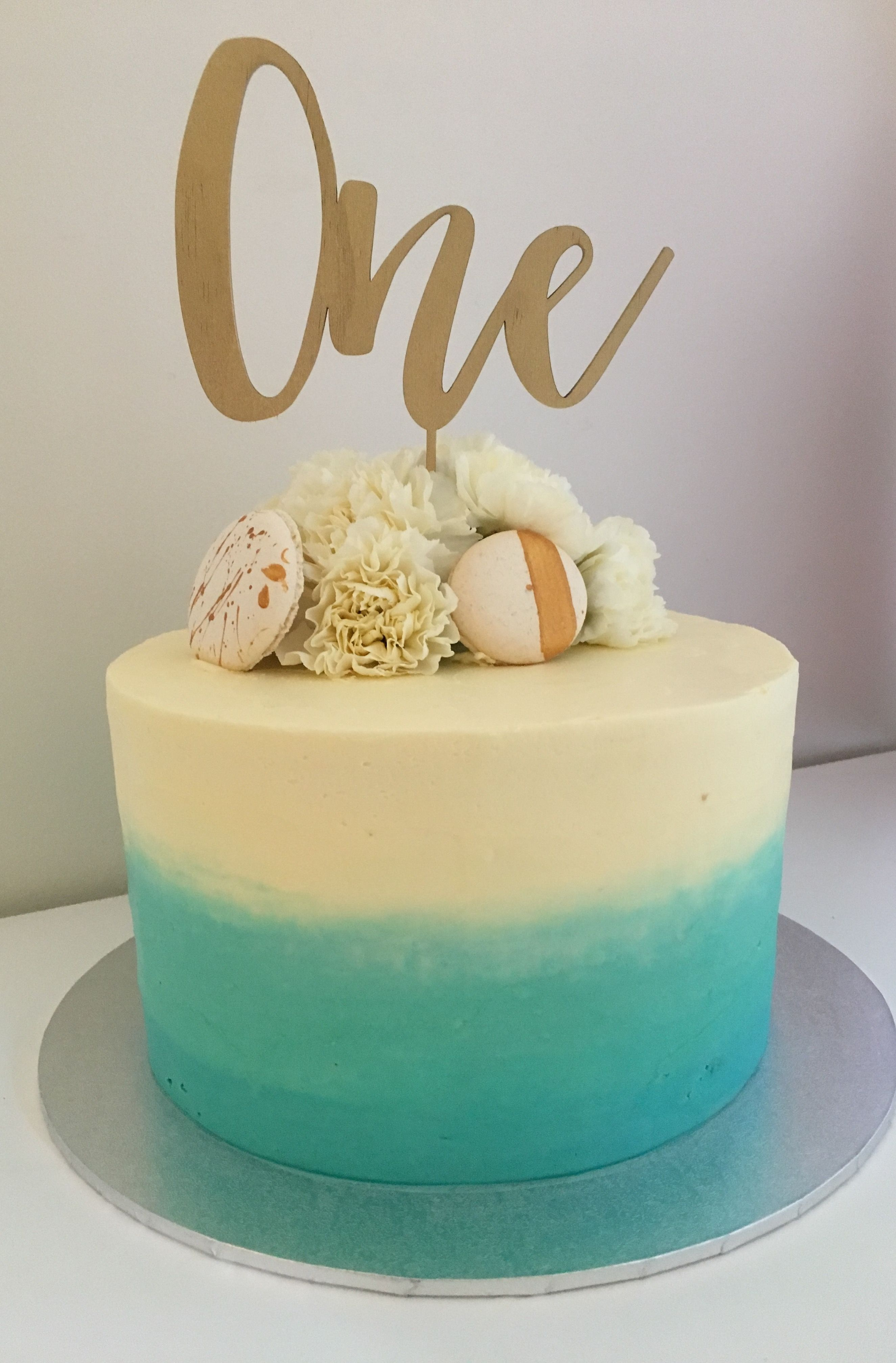Ombré real blue and white first birthday cake