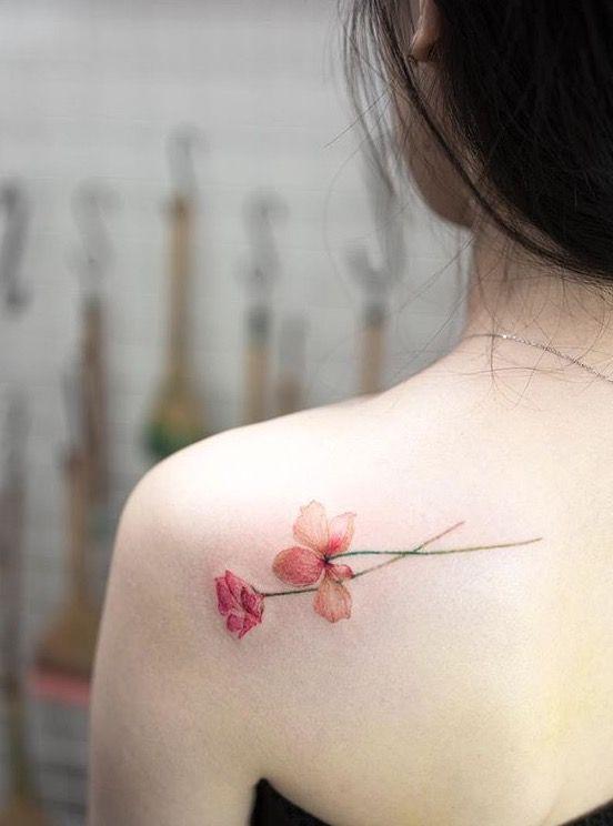 d4e7f91e220b8 Delicate flower tattoo on the shoulder blade. #flower #tattoo #backtattoo  #shouldertattoo