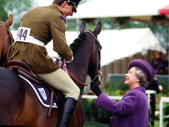 Queen Elizabeth II hands out prizes to riders at The Royal Windsor Horse Show, 1991. From #QueenElizabeth's Royal Love of #Horses on www.AuthorAngelaBell.com.