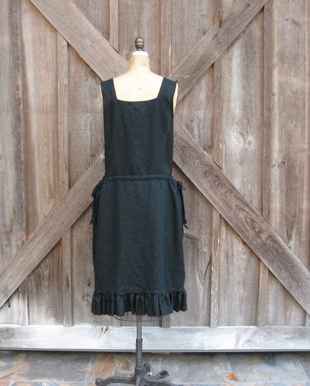 linen jumper pinafore apron dress  in black. $139.00, via Etsy.