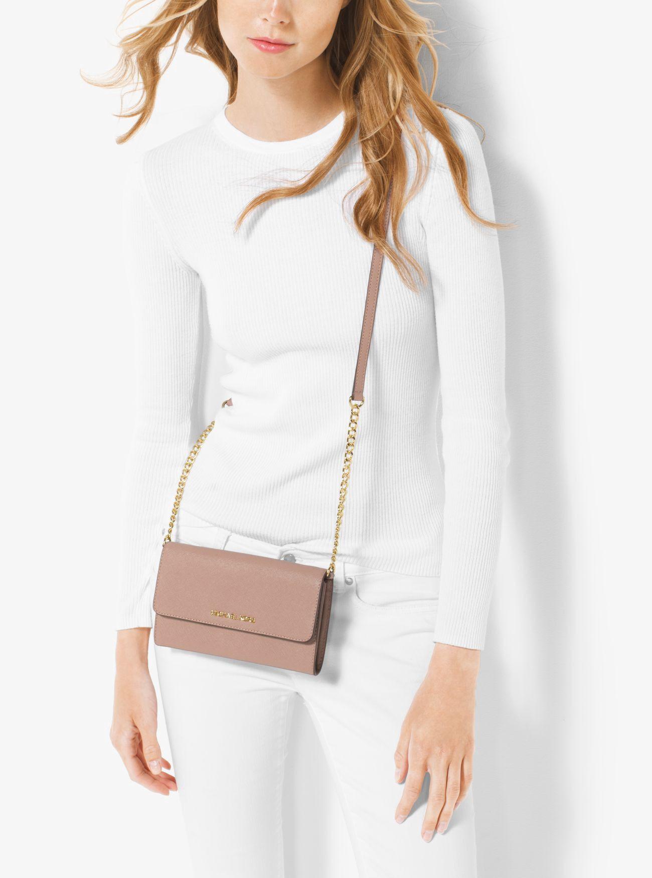 fb7b0fb0be6465 MICHAEL KORS Jet Set Travel Saffiano Leather Smartphone Crossbody. # michaelkors #bags #shoulder bags #leather #polyester #crossbody #lining #