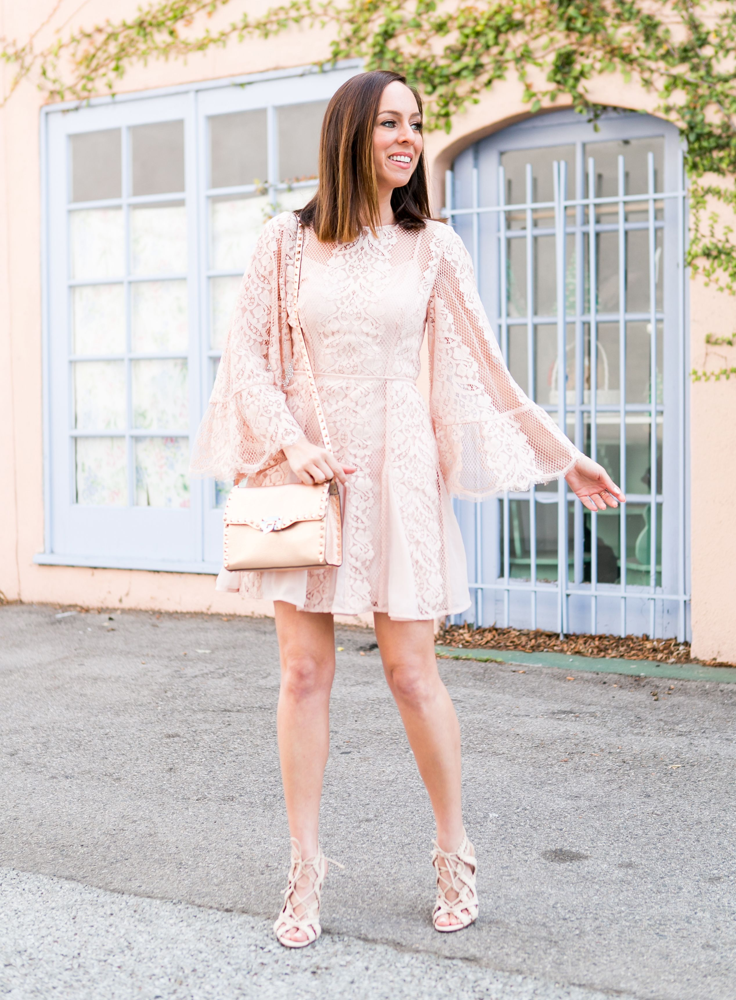 7ced2b365ae0 Sydne Style shows what to wear to graduation in pink lace dress #pink  #blush #lace #bellsleeves #dresses #valentino