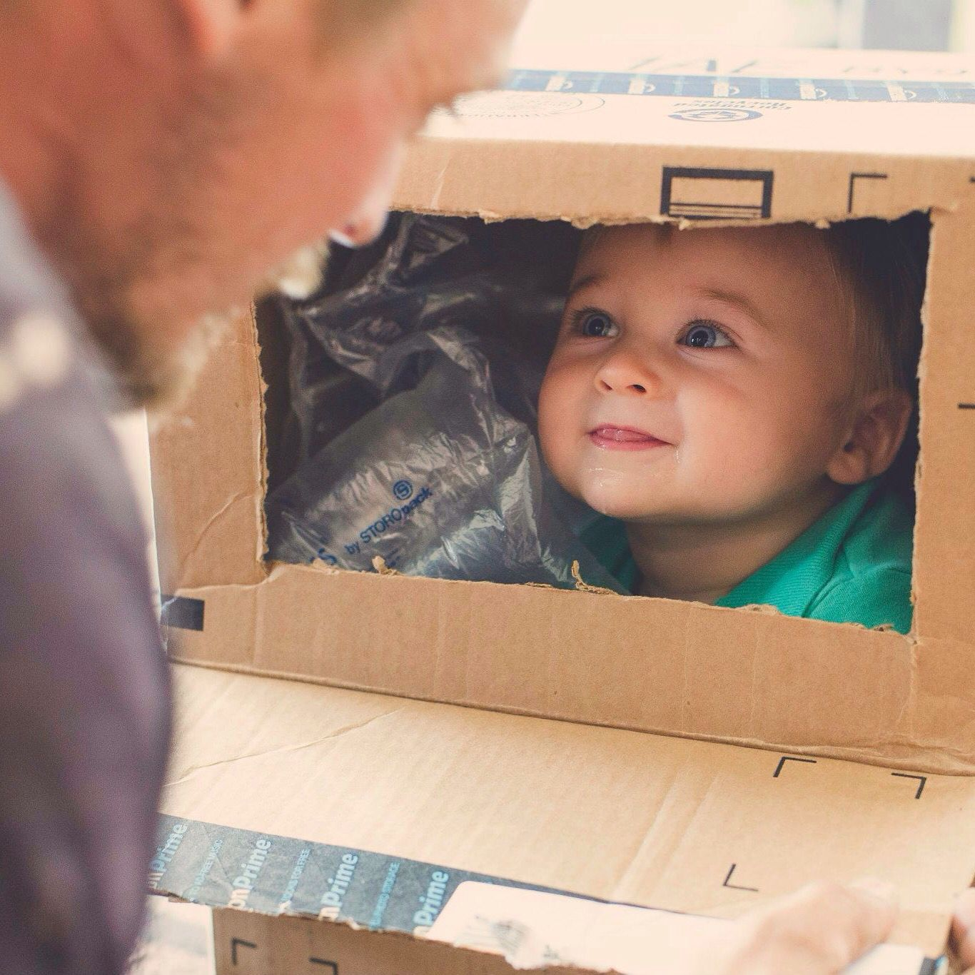 Ryan and daddy playing in boxes