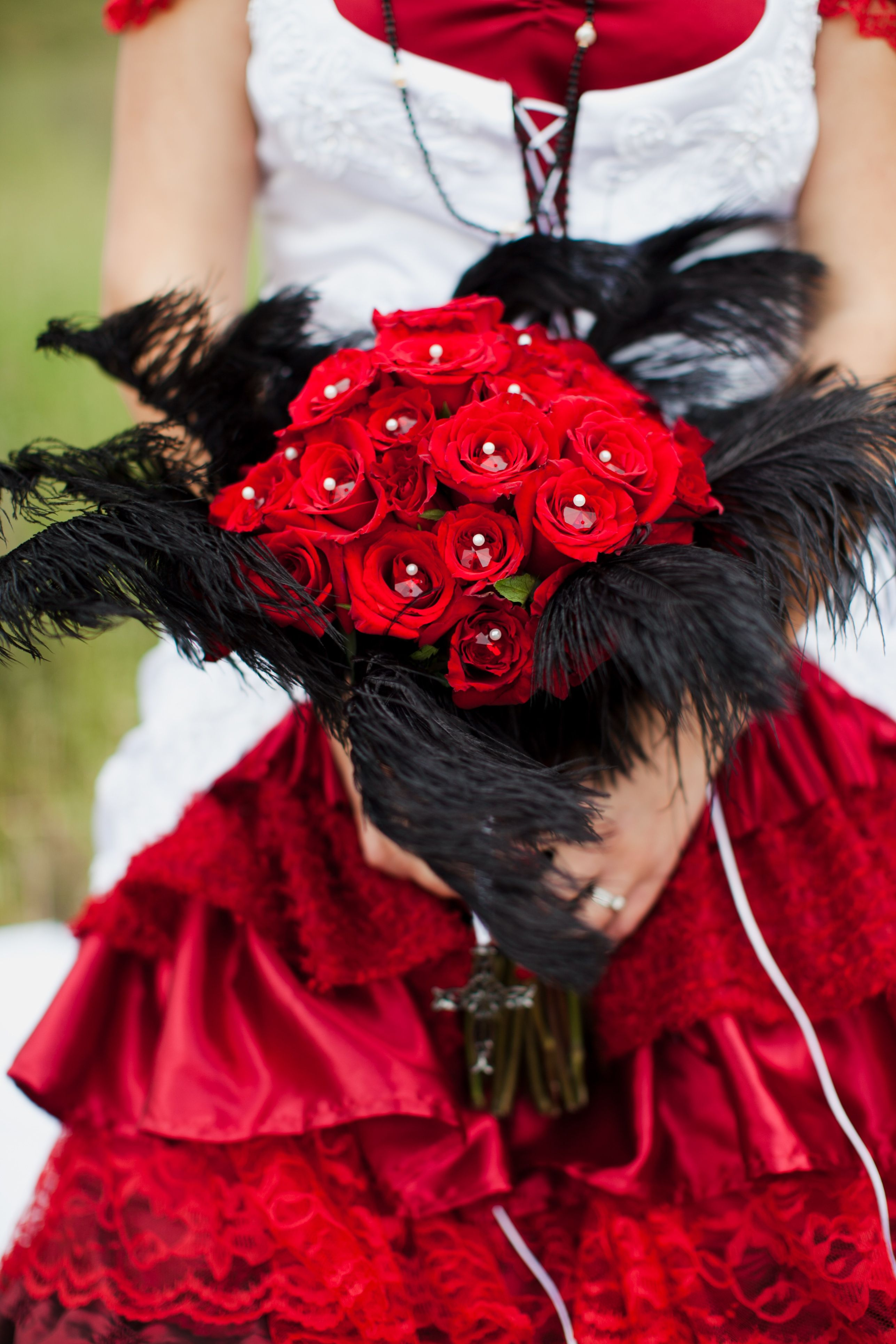This boquet was made with 50 red roses from Costco, black ostrich ...