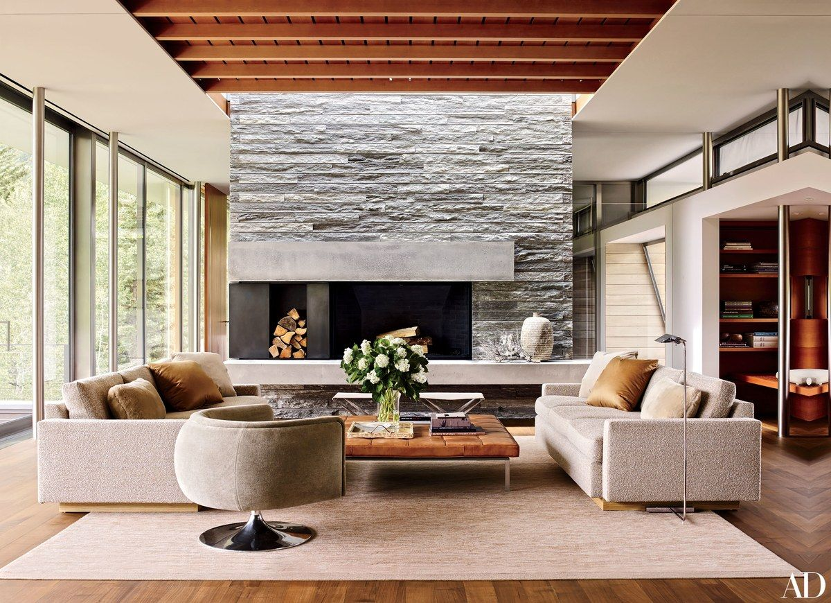 A quartzite chimney breast defines one end of the open plan living dining kitchen area