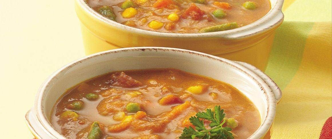Canned pumpkin, tomatoes and broth become the base for a tasty, colorful soup.